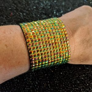 Statement iridescent green magnetic bracelet